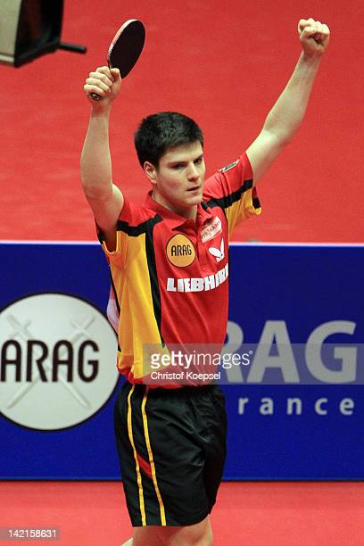 Dimitrij Ovtcharov of Germany celebrates his victory against Jun Mitzutani of Japan during the LIEBHERR table tennis team world cup 2012 championship...