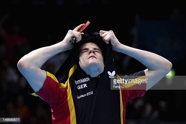 Dimitrij Ovtcharov of Germany celebrates winning the Men's Singles Table Tennis quarterfinal match against Michael Maze of Denmark on Day 4 of the...
