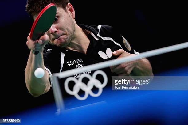 Dimitrij Ovtcharov of Germany competes against Li Ping of Qatar during Round 3 of the Men's Singles Table Tennis on Day 3 of the Rio 2016 Olympic...