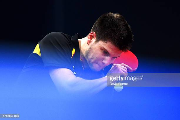 Dimitrij Ovtcharov of Germany competes in the Table Tennis Men's Team's first round match against Carlos Machado of Spain during day one of the Baku...