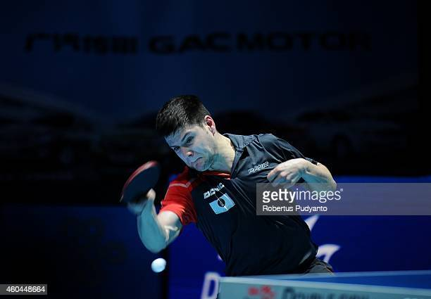 Dimitrij Ovtcharov of Germany in action during Men's single semi final of the 2014 ITTF World Tour Grand Finals at Huamark Indoor Stadium on December...