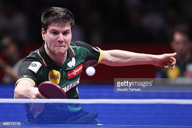 Dimitrij Ovtcharov of Germany plays a backhand against Jike Zhang of China during day eight of the 2014 World Team Table Tennis Championships at...