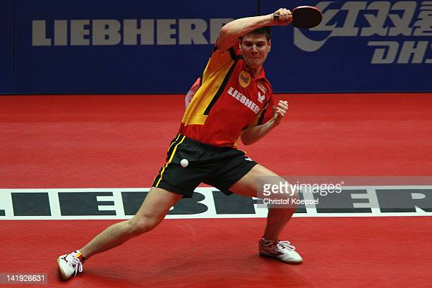 Dimitrij Ovtcharov of Germany plays a forehand during his match against Gao Ning of Singapore during the LIEBHERR table tennis team world cup 2012...