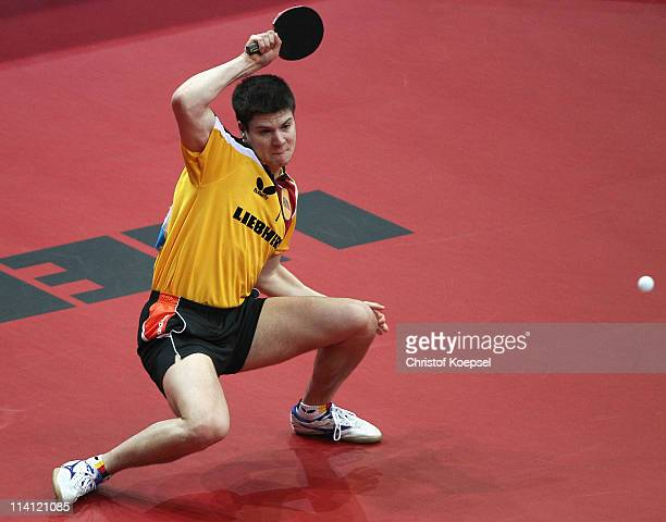 Dimitrij Ovtcharov of Germany plays a forehand during the Round 32 Men's Single match between Dimitrij Ovtcharov of Germany and Seiya Kishikawa of...