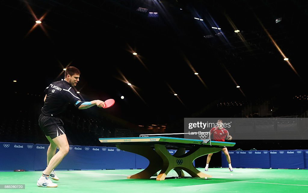 Dimitrij Ovtcharov of Germany practices with team mate Timo Boll of Germany during a training session for table tennis at the Rio Centro Pavilion for the 2016 Summer Olympic Games on August 2, 2016 in Rio de Janeiro, Brazil.