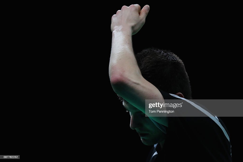 Dimitrij Ovtcharov of Germany reacts after giving up a point to Vladimir Samsonov of Belarus during the Men's Singles Quarterfinal 3 Table Tennis on Day 4 of the Rio 2016 Olympic Games at the Riocentro Pavilion 3 on August 9, 2016 in Rio de Janeiro, Brazil.