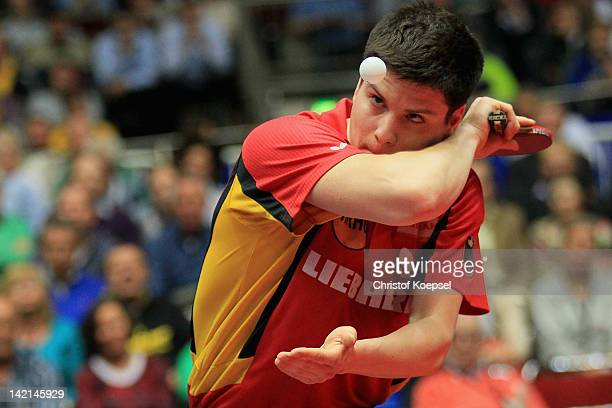Dimitrij Ovtcharov of Germany serves during his match against Joergen Persson of Sweden during the match against Jens Lundqvist of Sweden during the...