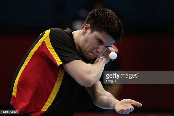 Dimitrij Ovtcharov of Germany serves during Men's Singles Table Tennis Bronze medal match against ChihYuan Chuang of Chinese Taipei on Day 6 of the...