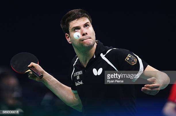 Dimitrij Ovtcharov of Germany serves during the Table Tennis Men's Team Round One Match between Germany and Chinese Taipei during Day 8 of the Rio...