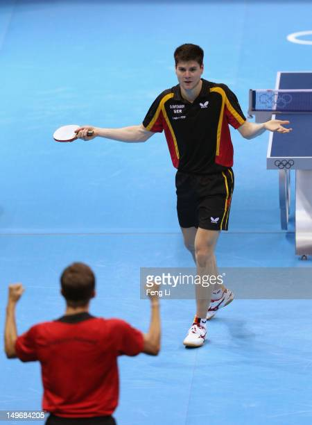 Dimitrij Ovtcharov of Germany turns to his Coach Jorg Rosskopf as he wins the Men's Singles Table Tennis Bronze medal match against ChihYuan Chuang...