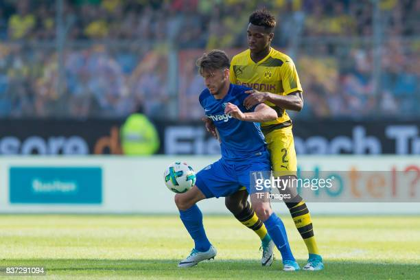 Dimitrios Diamantakos of Bochum and DanAxel Zagadou of Dortmund battle for the ball during the preseason friendly match between VfL Bochum and...