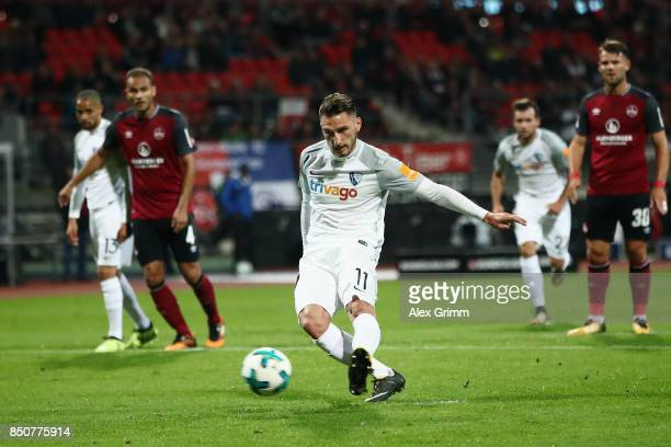 Dimitrios Diamantakos of Bochum scores his team's first goal from the penalty spot during the Second Bundesliga match between 1 FC Nuernberg and VfL...