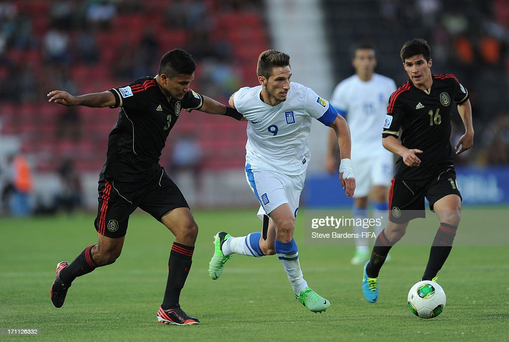 Dimitrios Diamantakos of Greece holds off Hedgardo Marin of Mexico during the FIFA U20 World Cup Group D match between Mexico and Greece at Kamil Ocak Stadium on June 22, 2013 in Gaziantep, Turkey.