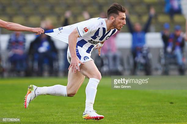 Dimitrios Diamantakos of Karlsruhe celebrates his team's first goal with team mate Grischa Proemel during the Second Bundesliga match between...