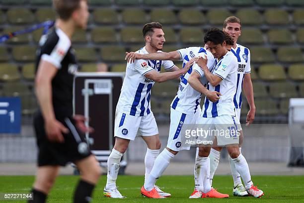 Dimitrios Diamantakos of Karlsruhe celebrates his team's third goal with team mates during the Second Bundesliga match between Karlsruher SC and SV...
