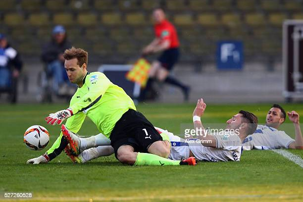 Dimitrios Diamantakos of Karlsruhe scores his team's first goal past goalkeeper Marco Knaller of Sandhausen during the Second Bundesliga match...