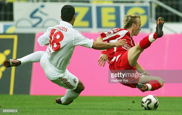 Dimitrios Grammozis of Cologne and Michael Thurk of Mainz vie for a ball during the Bundesliga match between 1FC Cologne and FSV Mainz 05 at the...