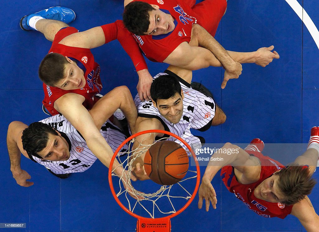 Dimitrios Mavroeidis (C) and Marko Banic (L) of Gescrap BB compete with Andrey Vorontsevich (2nd L) Alexander Kaun (3rd L) and <a gi-track='captionPersonalityLinkClicked' href=/galleries/search?phrase=Andrei+Kirilenko&family=editorial&specificpeople=201909 ng-click='$event.stopPropagation()'>Andrei Kirilenko</a> (R) of CSKA Moscow during the Play Off A Game Day 1 between CSKA Moscow v Gescrap BB at A. Gomelsky Universal Sports Hall on March 21, 2012 in Moscow, Russia.