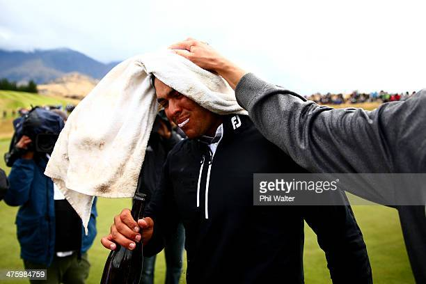Dimitrios Papadatos of Australia celebrates with champagne after winning the New Zealand Open at The Hills Golf Club on March 2 2014 in Queenstown...