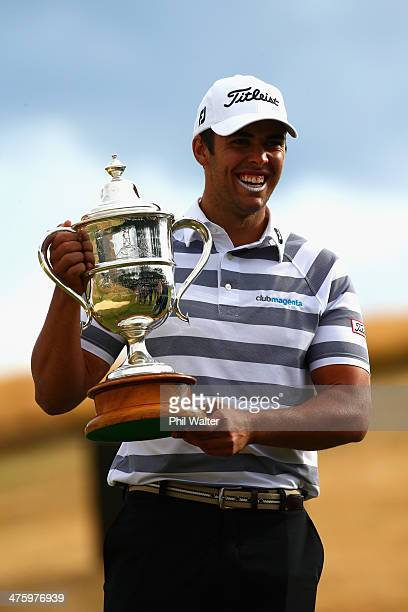 Dimitrios Papadatos of Australia holds the New Zealand Open trophy after winning the New Zealand Open at The Hills Golf Club on March 2 2014 in...