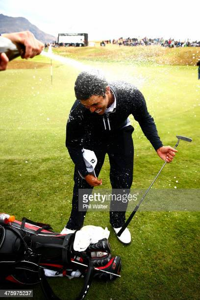 Dimitrios Papadatos of Australia is sprayed with champagne after winning the New Zealand Open at The Hills Golf Club on March 2 2014 in Queenstown...