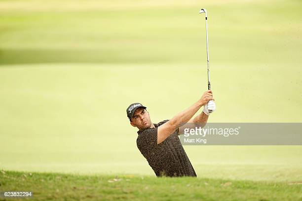 Dimitrios Papadatos of Australia plays out of the fairway bunker on the 11th hole during day one of the 2016 Australian Open at Royal Sydney Golf...