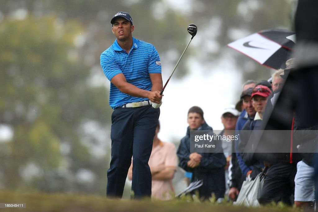 Dimitrios Papadatos of Australia watches his approach shot on the 18th hole during day three of the Perth International at Lake Karrinyup Country Club on October 19, 2013 in Perth, Australia.