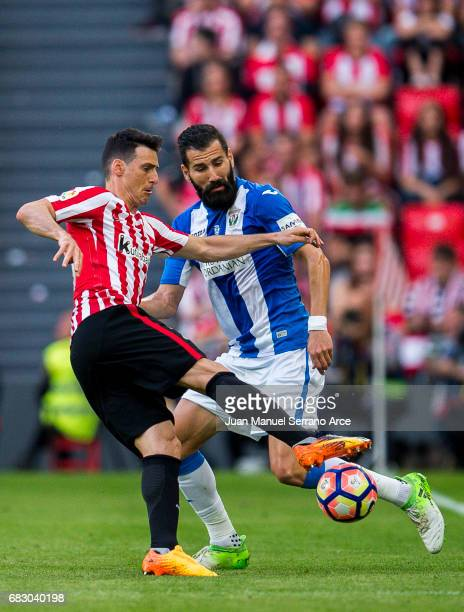 Dimitrios Siovas of Club Deportivo Leganes competes for the ball with Aritz Aduriz of Athletic Club during the La Liga match between Athletic Club...