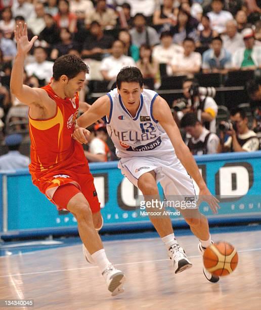 Dimitris Diamantidis of Greece tries to brush off Spaniard defender Jose Manuel Calderon during the FIBA World Championship 2006 Final between Spain...