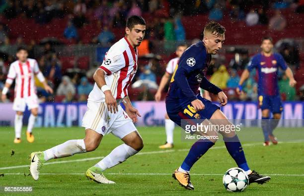Dimitris Nikolaou of Olympiacos puts pressure on Gerard Deulofeu of Barcelona during the UEFA Champions League group D match between FC Barcelona and...