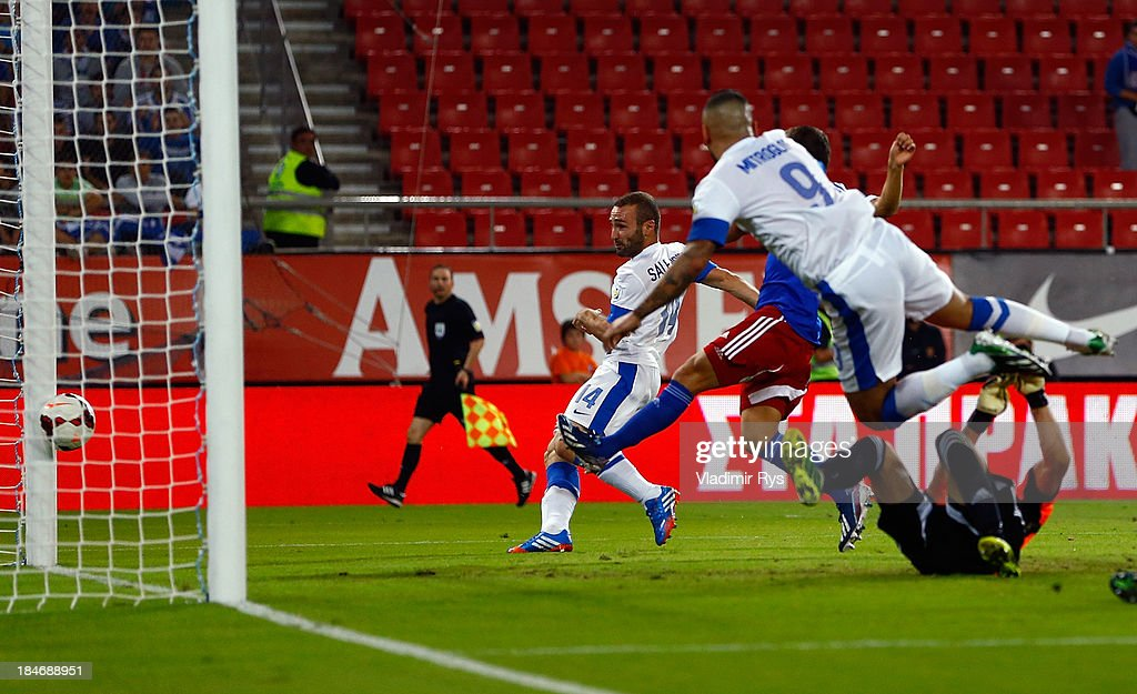 Dimitris Salpigidis of Greece scores his team's first goal during the group G FIFA 2014 World Cup Qualifier match between Greece and Liechtenstein at Karaiskakis Stadium on October 15, 2013 in Athens, Greece.