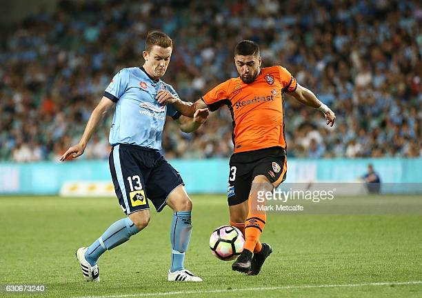 Dimitro Petratos of the Roar and Brandon O'Neill of Sydney FC compete for the ball during the round 13 ALeague match between Sydney FC and Brisbane...