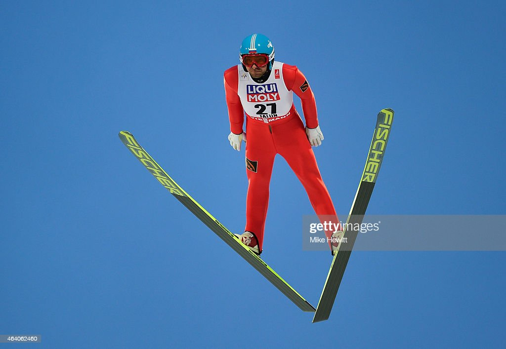 <a gi-track='captionPersonalityLinkClicked' href=/galleries/search?phrase=Dimitry+Vassiliev&family=editorial&specificpeople=4125842 ng-click='$event.stopPropagation()'>Dimitry Vassiliev</a> of Russia competes during the Men's HS100 Normal Hill Ski Jumping during the FIS Nordic World Ski Championships at the Lugnet venue on February 21, 2015 in Falun, Sweden.