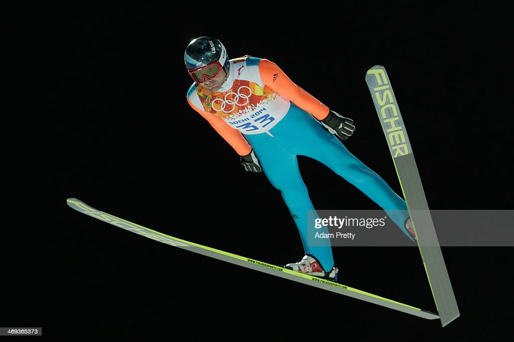<a gi-track='captionPersonalityLinkClicked' href=/galleries/search?phrase=Dimitry+Vassiliev&family=editorial&specificpeople=4125842 ng-click='$event.stopPropagation()'>Dimitry Vassiliev</a> of Russia jumps during the Men's Large Hill Individual Qualification on day 7 of the Sochi 2014 Winter Olympics at the RusSki Gorki Ski Jumping Center on February 14, 2014 in Sochi, Russia.