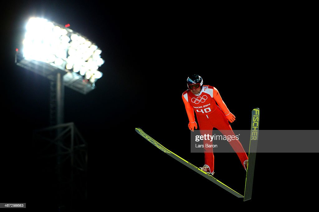 <a gi-track='captionPersonalityLinkClicked' href=/galleries/search?phrase=Dimitry+Vassiliev&family=editorial&specificpeople=4125842 ng-click='$event.stopPropagation()'>Dimitry Vassiliev</a> of Russia jumps during the Men's Normal Hill Individual Ski Jumping training ahead of the Sochi 2014 Winter Olympics at the RusSki Gorki Ski Jumping Center on February 6, 2014 in Sochi, Russia.