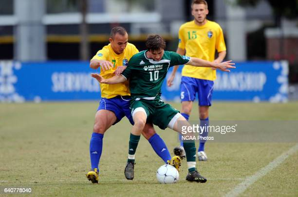 Dimo Krymanidis of Fort Lewis and David Palmer of LeesMcRae battle for the ball during the Division II Men's Soccer Championship held at Pepin...