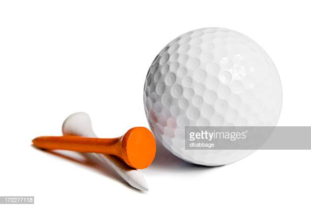 Dimpled golf ball and two tees on a white background