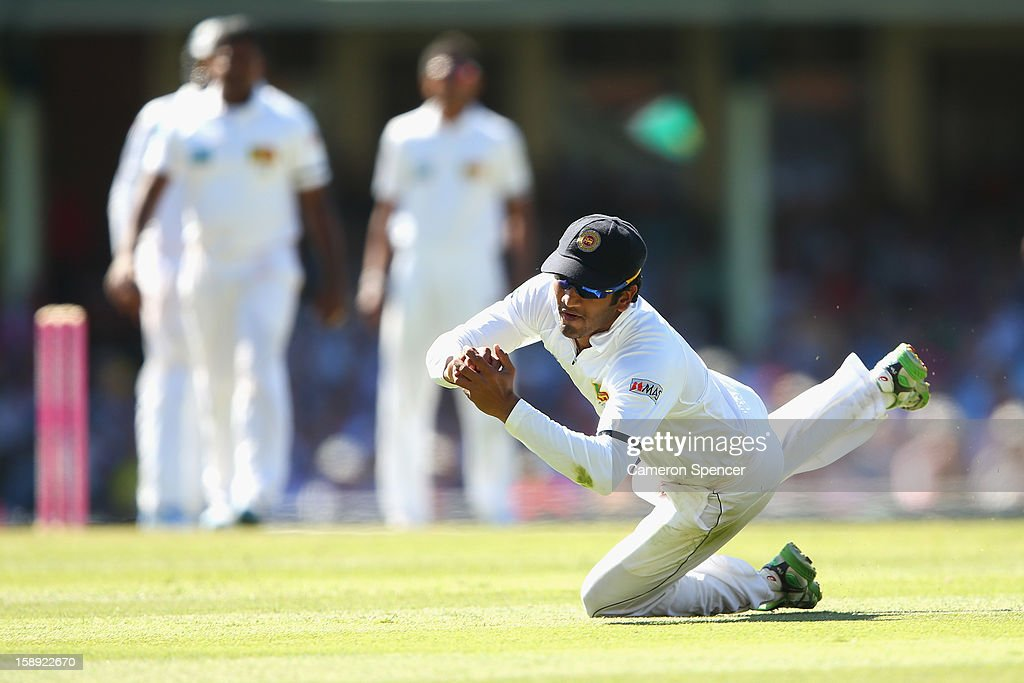Dimuth Karunaratne catches out Australian captain Michael Clarke off a delivery by Rangana Herath of Sri Lanka during day two of the Third Test match between Australia and Sri Lanka at Sydney Cricket Ground on January 4, 2013 in Sydney, Australia.