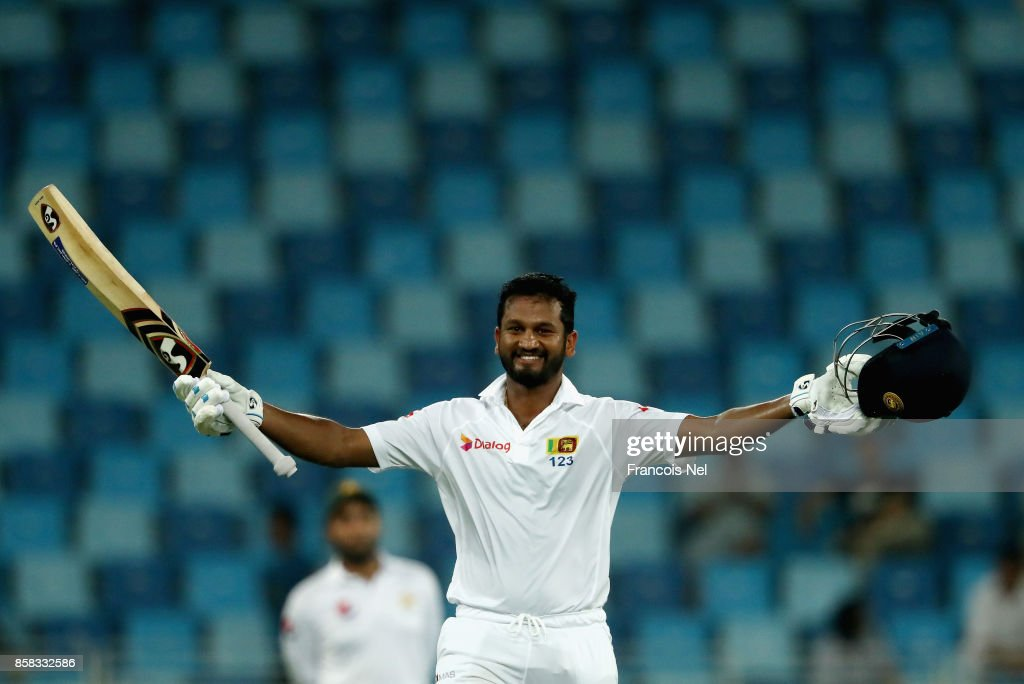 Dimuth Karunaratne of Sri Lanka celebrate after reaching his century during Day One of the Second Test between Pakistan and Sri Lanka at Dubai International Cricket Ground on October 6, 2017 in Dubai, United Arab Emirates.