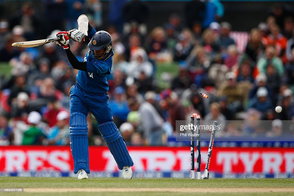 Dimuth Karunaratne of Sri Lanka is bowled by Adam Milne of New Zealand during the 2015 ICC Cricket World Cup match between Sri Lanka and New Zealand at Hagley Oval on February 14, 2015 in Christchurch, New Zealand.