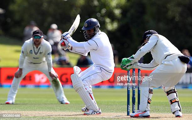 Dimuth Karunaratne of Sri Lanka knicks the ball to be caught by BJ Watling of New Zealand during day two of the First Test match between New Zealand...