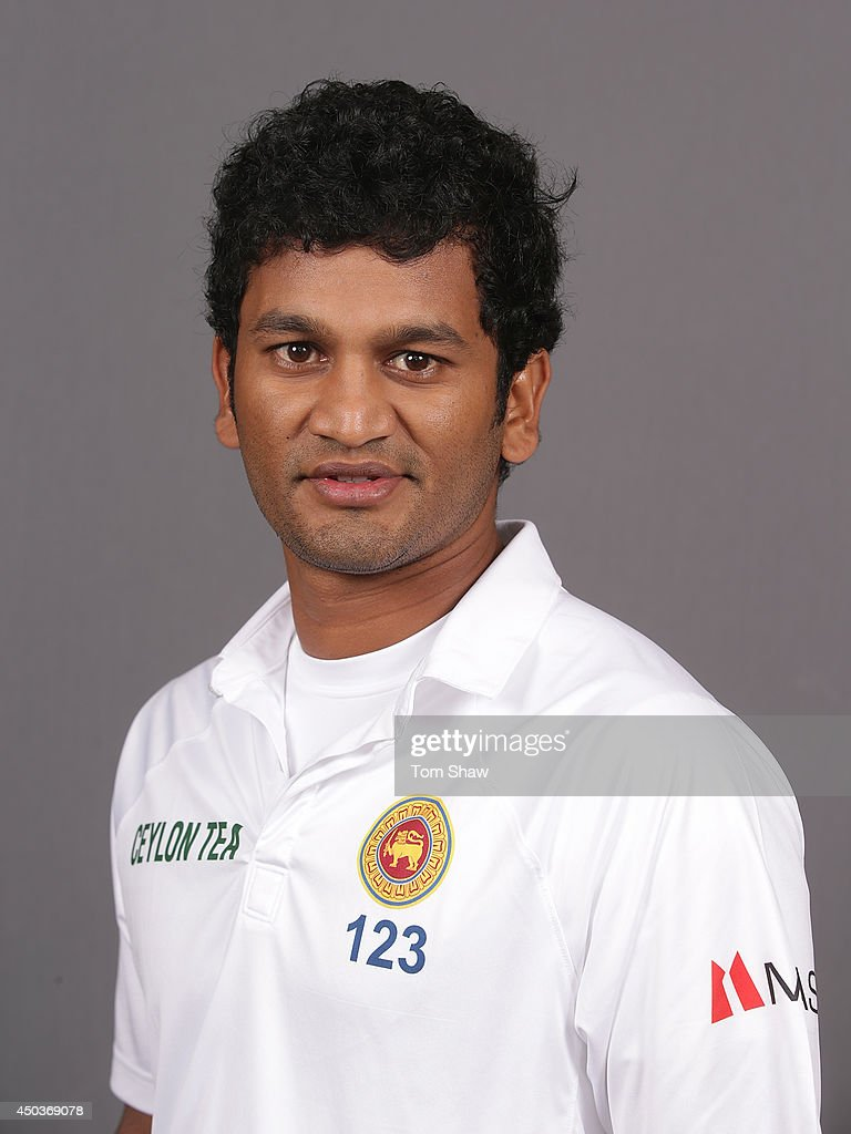 <a gi-track='captionPersonalityLinkClicked' href=/galleries/search?phrase=Dimuth+Karunaratne&family=editorial&specificpeople=7915648 ng-click='$event.stopPropagation()'>Dimuth Karunaratne</a> of Sri Lanka poses for a headshot during the Sri Lanka portrait session at Lord's Cricket Ground on June 10, 2014 in London, England.
