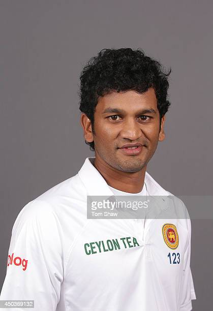 Dimuth Karunaratne of Sri Lanka poses for a headshot during the Sri Lanka portrait session at Lord's Cricket Ground on June 10 2014 in London England