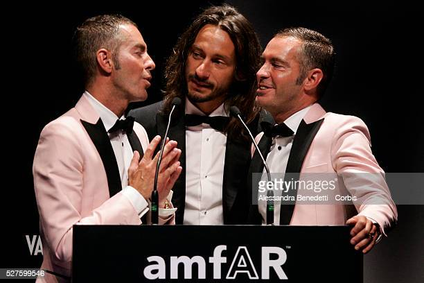 Din Dan Caten and DJ Bob Sinclair attend the Amfar Aids Research gala and auction in Milan