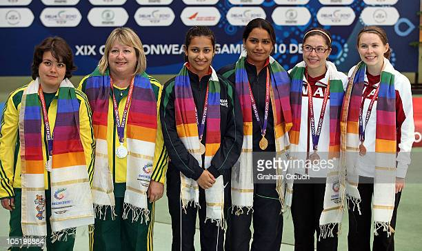 Dina Aspandiyarova and Pamela McKenzie of Australia Heena Sidhu and Annu Raj Singh of India and Lynda Hare and Dorothy Ludwig if Canada after...