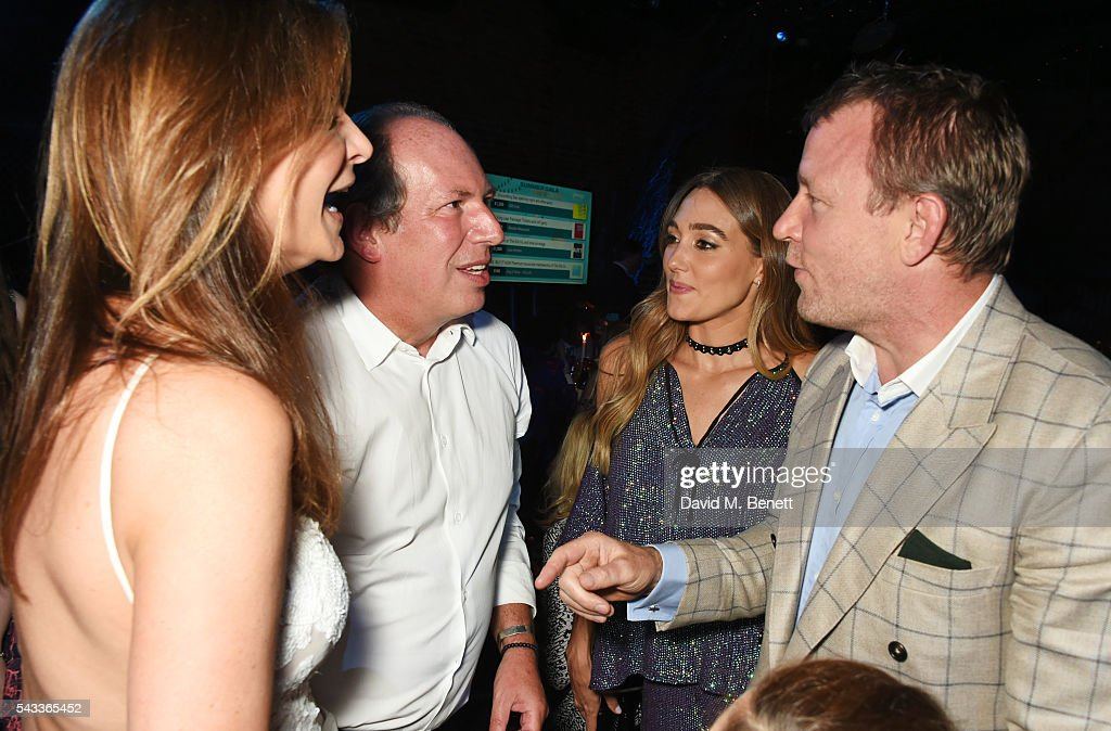 Dina De Luca, <a gi-track='captionPersonalityLinkClicked' href=/galleries/search?phrase=Hans+Zimmer&family=editorial&specificpeople=243005 ng-click='$event.stopPropagation()'>Hans Zimmer</a>, <a gi-track='captionPersonalityLinkClicked' href=/galleries/search?phrase=Jacqui+Ainsley&family=editorial&specificpeople=209223 ng-click='$event.stopPropagation()'>Jacqui Ainsley</a> and <a gi-track='captionPersonalityLinkClicked' href=/galleries/search?phrase=Guy+Ritchie&family=editorial&specificpeople=239519 ng-click='$event.stopPropagation()'>Guy Ritchie</a> attend the Summer Gala for The Old Vic at The Brewery on June 27, 2016 in London, England.