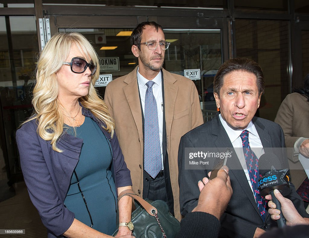 Dina Lohan (L) and Attorney Mark Heller (R) appear at Nassau County First District Court after her arrest on September 12, 2013 on suspicion of driving while intoxicated after she was pulled over for speeding on Long Island, on October 23, 2013 in Hempstead, New York.