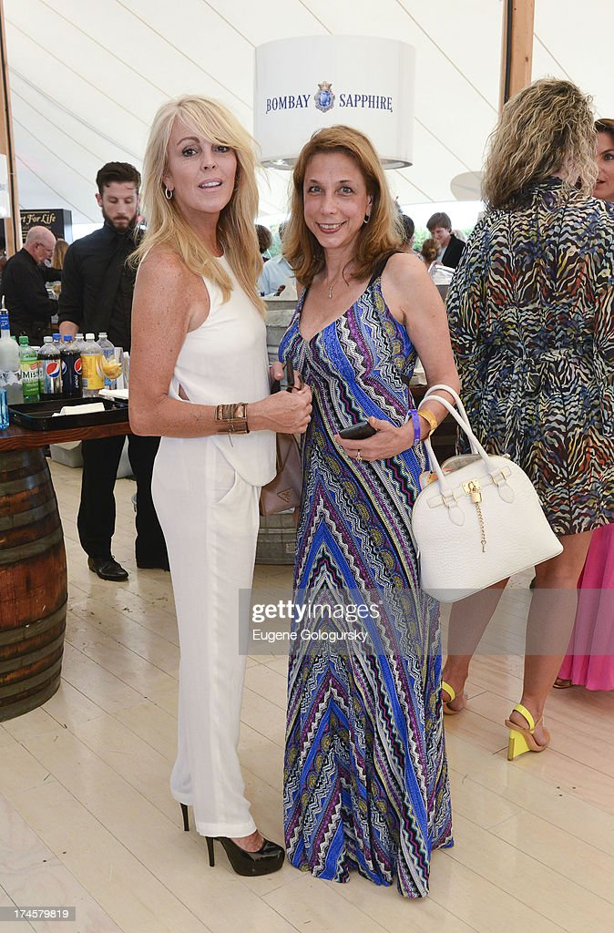 <a gi-track='captionPersonalityLinkClicked' href=/galleries/search?phrase=Dina+Lohan&family=editorial&specificpeople=594100 ng-click='$event.stopPropagation()'>Dina Lohan</a> and guest attend the Russell Simmons 14th Annual Art For Life Benefit Sponsored By BOMBAY SAPPHIRE Gin at Fairview Farms on July 27, 2013 in Bridgehampton, New York.