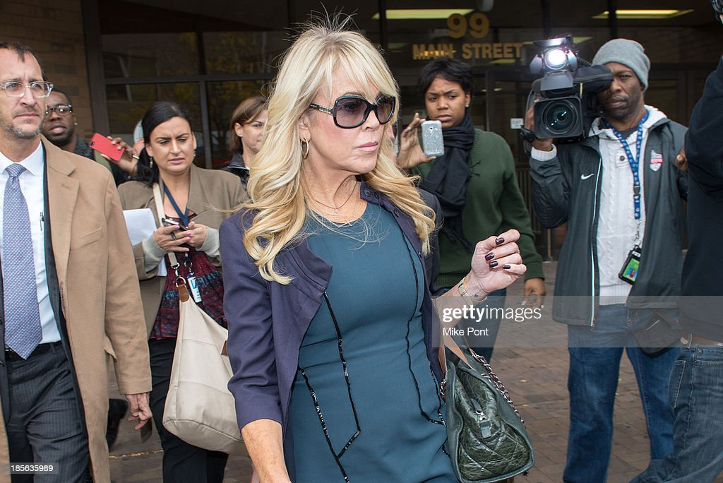 <a gi-track='captionPersonalityLinkClicked' href=/galleries/search?phrase=Dina+Lohan&family=editorial&specificpeople=594100 ng-click='$event.stopPropagation()'>Dina Lohan</a> appears at Nassau County First District Court after her arrest on September 12, 2013 on suspicion of driving while intoxicated after she was pulled over for speeding on Long Island, on October 23, 2013 in Hempstead, New York.