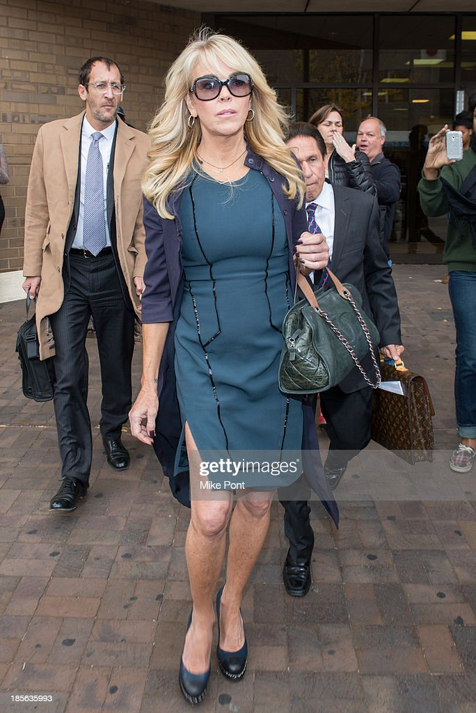Dina Lohan appears at Nassau County First District Court after her arrest on September 12, 2013 on suspicion of driving while intoxicated after she was pulled over for speeding on Long Island, on October 23, 2013 in Hempstead, New York.
